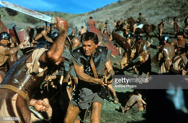 Kirk Douglas the slave Spartacus engaged in battle in a scene from the film 'Spartacus' 1960