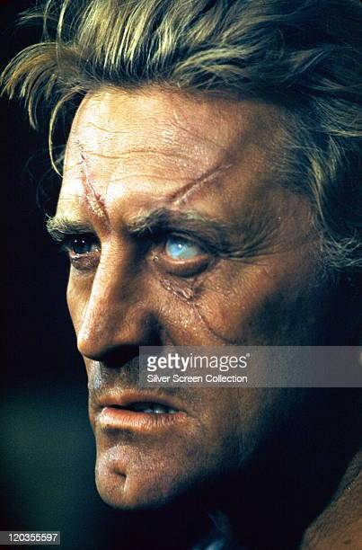 Kirk Douglas US actor with a milkywhite dead eye and scars across his face in a publicity still issued for the film 'The Vikings' 1958 The action...