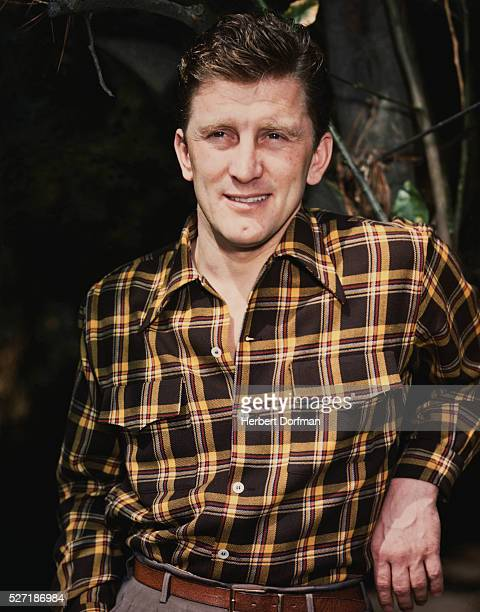 Kirk Douglas Wearing a Dress Shirt and Slacks