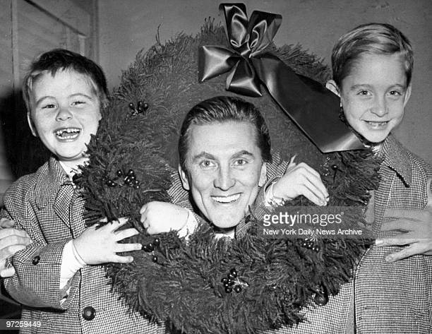 Kirk Douglas with sons Joel and Michael at Idlewild Airport