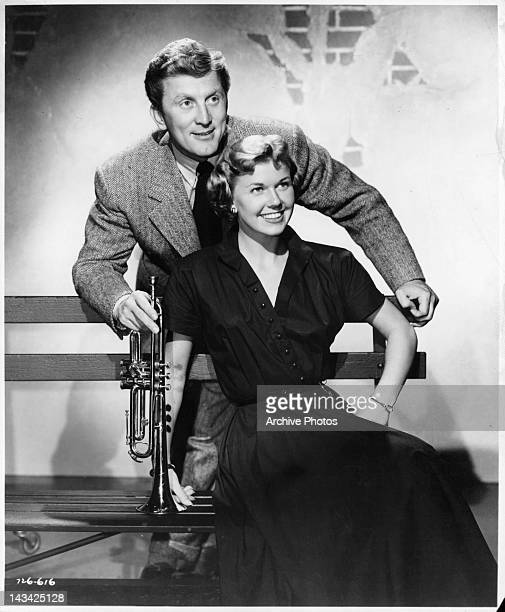 Kirk Douglas with trumpet hanging over Doris Day in a scene from the film 'Young Man With A Horn' 1950