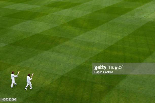 Kirk Edwards and Kieran Powell of the West Indies take the field at the start of the innings during day two of the Second Test match between New...