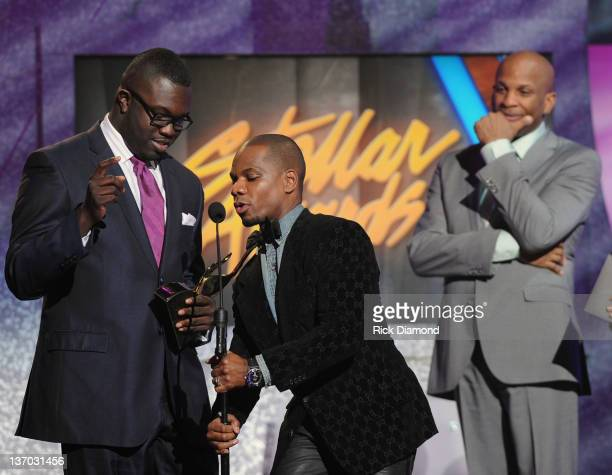 Kirk Franklin receives Song of the Year award while Darius Paulk and Donnie McClurkin look on Kirk Franklin shares the award with Darius Paulk during...
