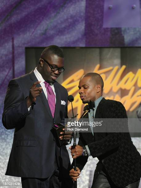 Kirk Franklin receives Song of the Year award while Darius Paulk look on Kirk Franklin shares the award with Darius Paulk during the 27th Annual...