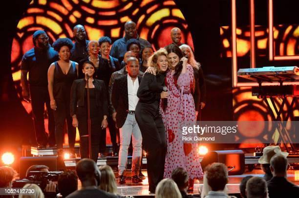 Kirk Franklin Tori Kelly and Hillary Scott of musical group Lady Antebellum perform onstage during the 2018 CMT Artists of The Year at Schermerhorn...