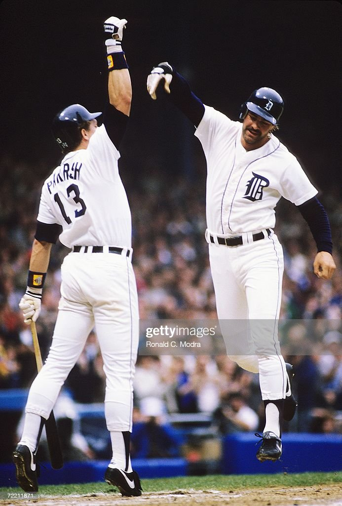 Kirk Gibson #23 of the Detroit Tigers high fives with Lance Parrish #13 of the Detroit Tigers after hitting his first home run in Game 5 of the 1984 World Series against the San Diego Padres at Tigers Stadium on October 14, 1984 in Detroit, Michigan. The Tigers defeated the Padres8-4 to win the series.