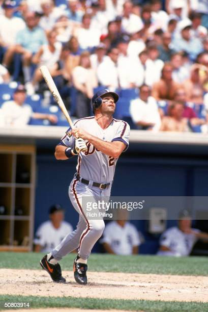 Kirk Gibson of the Detroit Tigers watches the flight of the ball as he follows through on a swing during a game on July 20, 1994 at Tiger Stadium in...