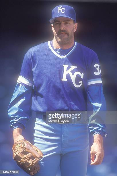 Kirk Gibson of the Kansas City Royals plays catch before a baseball game against the Detroit Tigers on May 8 1991 at Tiger Stadium in Detroit Michigan