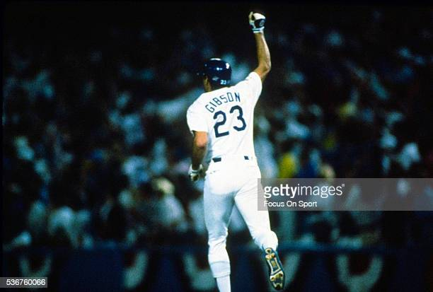Kirk Gibson of the Los Angeles Dodgers celebrates as he trots around the bases after hitting a game winning pitch-hit solo home run in the bottom of...