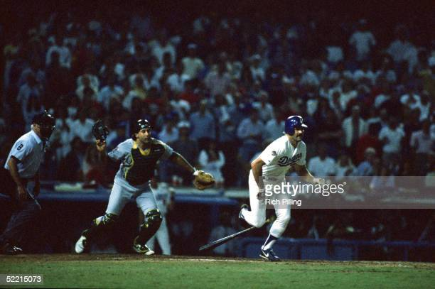 Kirk Gibson of the Los Angeles Dodgers makes a winning home run hit in the bottom of the ninth inning during game one of the 1988 World Series...