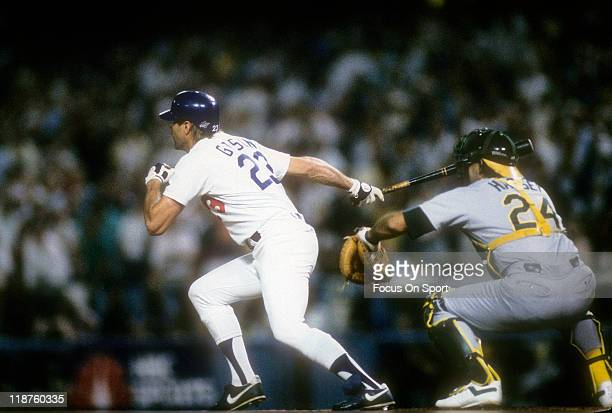Kirk Gibson of the Los Angeles Dodgers swing and hits a game winning pitchhit home run in the bottom of the ninth inning of game one against the...