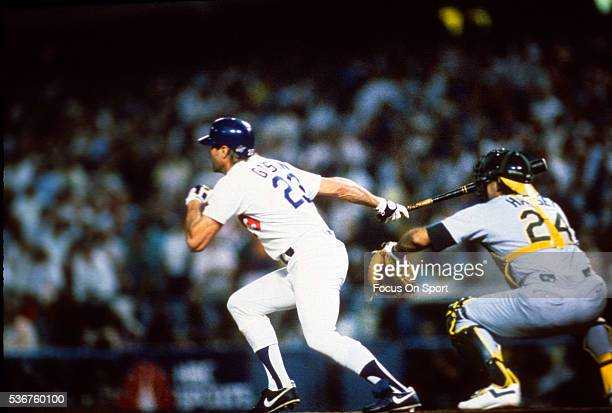 Kirk Gibson of the Los Angeles Dodgers swing and hits a game winning pitch-hit home run in the bottom of the ninth inning of game one against the...