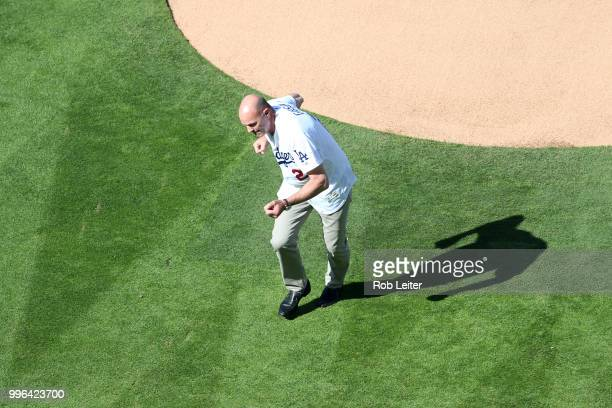 Kirk Gibson reacts after throwing out the first pitch before the game between the San Francisco Giants and the Los Angeles Dodgers at Dodger Stadium...