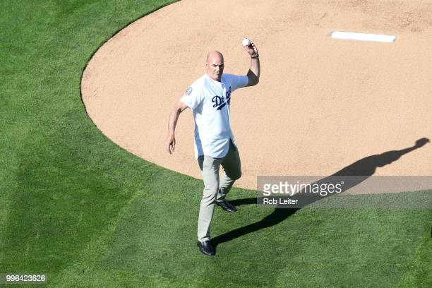 Kirk Gibson throws out the first pitch before the game between the San Francisco Giants and the Los Angeles Dodgers at Dodger Stadium on Thursday...