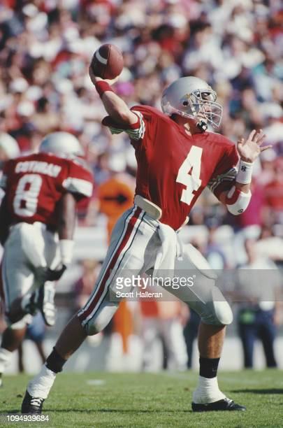 Kirk Herbstreit, Quarterback for the Ohio State Buckeyes throws the ball downfield during the NCAA Florida Citrus Bowl college football bowl game...