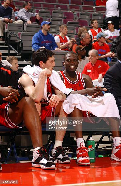 Kirk Hinrich and Luol Deng of the Chicago Bulls sit on the bench as the high scorers of a game they go on to win against the Detroit Pistons on April...