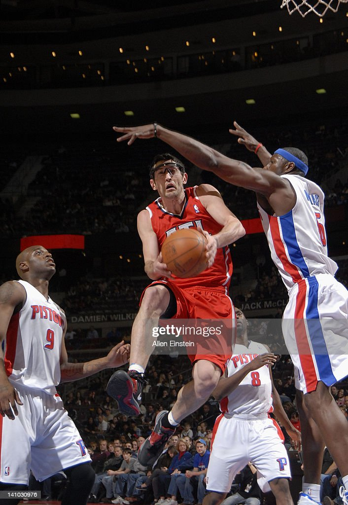 Kirk Hinrich #6 of the Atlanta Hawks goes to the basket against Ben Wallace #6 of the Detroit Pistons during the game on March 9, 2012 at The Palace of Auburn Hills in Auburn Hills, Michigan.