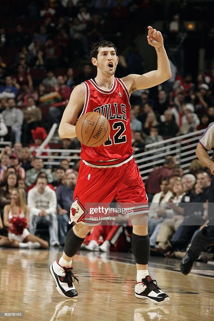 Kirk Hinrich of the Chicago Bulls calls a play as he moves