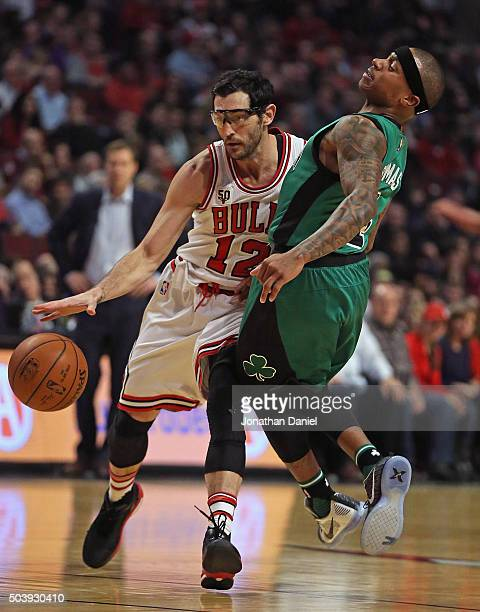 Kirk Hinrich of the Chicago Bulls colides with Isaiah Thomas of the Boston Celtics at the United Center on January 7 2016 in Chicago Illinois NOTE TO...
