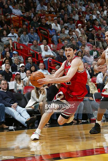 Kirk Hinrich of the Chicago Bulls dribble drives to the basket against the Miami Heat during the game at American Airlines Arena on March 29 2004 in...