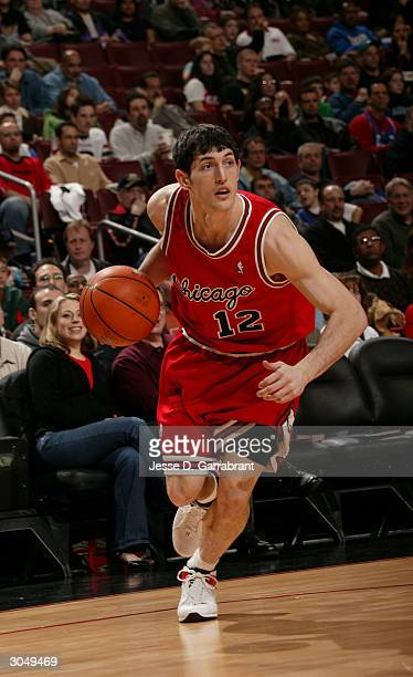 Kirk Hinrich of the Chicago Bulls drives to the net against the defense of the Philadelphia 76ers on March 6 2004 at the Wachovia Center in...