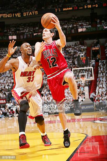 Kirk Hinrich of the Chicago Bulls goes to the basket against Alonzo Mourning of the Miami Heat in game five of the Eastern Conference Quarterfinals...