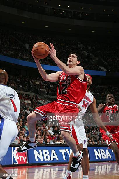 Kirk Hinrich of the Chicago Bulls goes up for a layup against Chauncey Billups of the Detroit Pistons a game on April 4, 2007 at the Palace of Auburn...