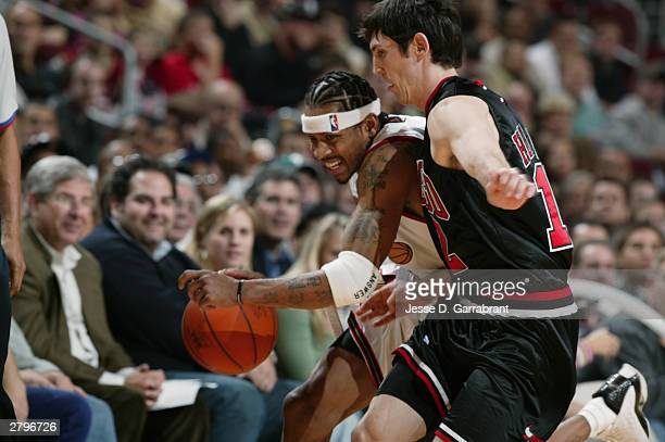 Kirk Hinrich of the Chicago Bulls guards Allen Iverson of the Philadelphia 76ers during a game at the Wachovia Center on December 4 2003 in...