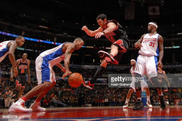 Kirk Hinrich of the Chicago Bulls loses the ball against Marcus Camby of the Los Angeles Clippers at Staples Center on January 20 2010 in Los Angeles...