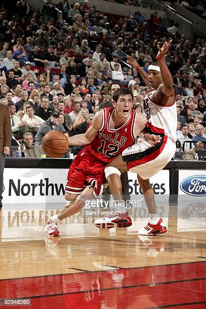 Kirk Hinrich of the Chicago Bulls takes the ball past Sebastian Telfair of the Portland Trail Blazers on March 9 2005 at the Rose Garden Arena in...