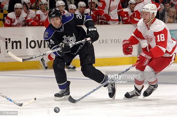 Kirk Maltby of the Detroit Red Wings defends against Alexander Frolov of the Los Angeles Kings during the first period of their game at the Staples...