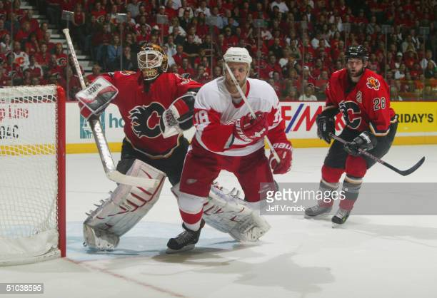 Kirk Maltby of the Detroit Red Wings follows the puck during Game 6 Round 2 of the NHL Western Conference Semifinals against the Calgary Flames at...