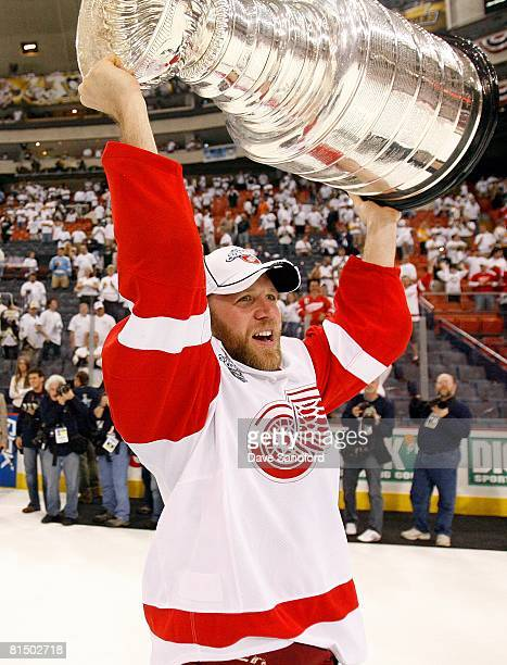 Kirk Maltby of the Detroit Red Wings hoists the Stanley Cup after defeating the Pittsburgh Penguins 3-2 in game six of the 2008 NHL Stanley Cup...