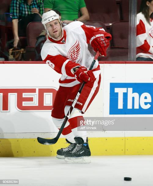 Kirk Maltby of the Detroit Red Wings passes the puck up ice during their game against the Vancouver Canucks at General Motors Place on October 27...