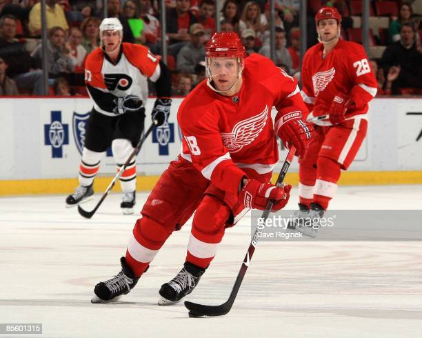 Kirk Maltby of the Detroit Red Wings skates with the puck during a NHL game against the Philadelphia Flyers on March 17 2009 at Joe Louis Arena in...