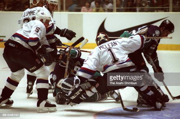 Kirk McLean of the Canucks saves a shot by Ted Drury of the Mighty Ducks in the NHL game between Mighty Ducks of Anaheim and Vancouver Canucks at the...