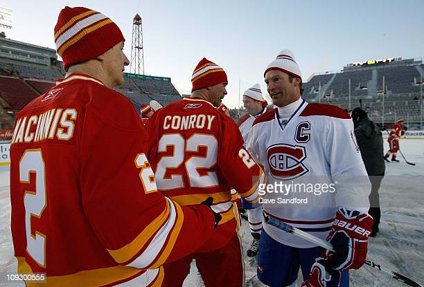 Kirk Muller of the Montreal Canadiens Alumni team shakes hands with Craig Conroy of the Calgary Flames Alumni after the 2011 Tim Hortons Heritage...