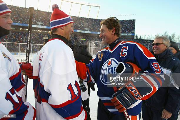 Kirk Muller of the Montreal Canadiens and Wayne Gretzky of the Edmonton Oilers shake hands after the Molson Canadien Heritage Classic Megastars Game...