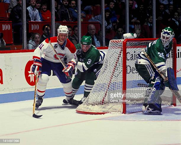 Kirk Muller of the Montreal Canadiens skates with the puck against the Hartford Whalers Circa 1990 at the Montreal Forum in Montreal Quebec Canada