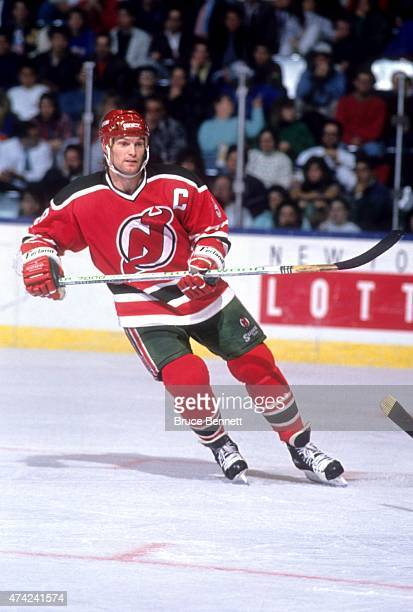 Kirk Muller of the New Jersey Devils skates on the ice during an NHL game against the New York Islanders in 1990 at the Nassau Coliseum in Uniondale...