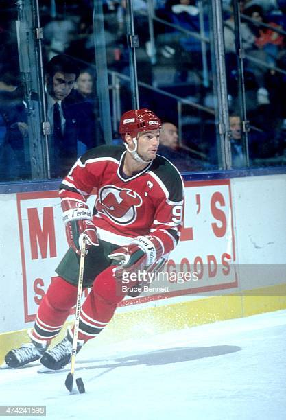 Kirk Muller of the New Jersey Devils skates with the puck during an NHL preseason game against the New York Islanders in September 1990 at the Nassau...