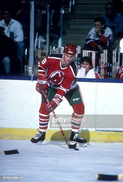 Kirk Muller of the New Jersey Devils skates with the puck during an NHL game against the New York Islanders on March 14 1987 at the Nassau Coliseum...