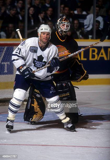 Kirk Muller of the Toronto Maple Leafs screens goalie Corey Hirsch of the Vancouver Canucks on November 26 1996 at the Maple Leaf Gardens in Toronto...
