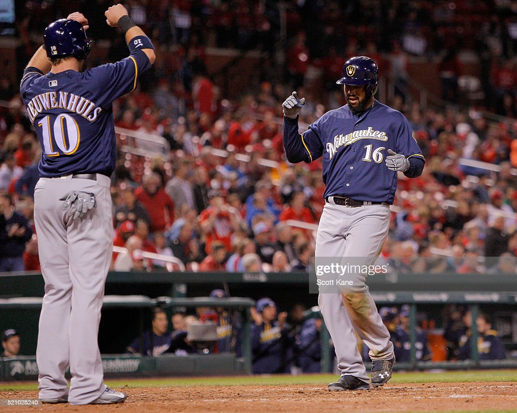 Kirk Nieuwenhuis #10 of the Milwaukee Brewers waits for Domingo Santana #16 as he crosses home plate after hitting a two-run home run during the ninth inning against the St. Louis Cardinals at Busch Stadium on April 13, 2016 in St. Louis, Missouri.