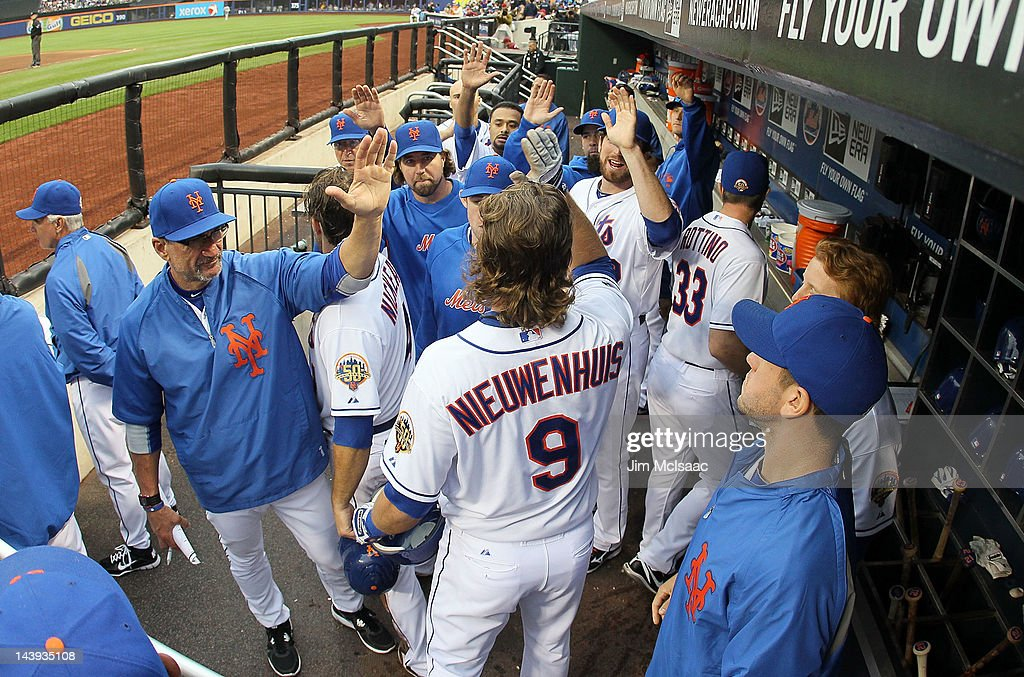 Kirk Nieuwenhuis #9 of the New York Mets celebrates scoring a fourth inning run against the Arizona Diamondbacks with his teammates in the dugout at Citi Field on May 5, 2012 in the Flushing neighborhood of the Queens borough of New York City.