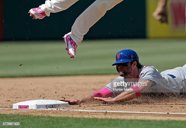 Kirk Nieuwenhuis of the New York Mets slides into third base in the sixth inning during a game against the Philadelphia Phillies at Citizens Bank...