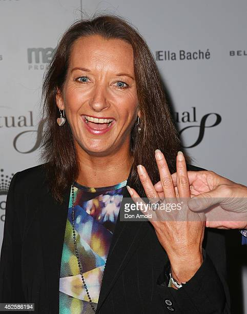 Kirk Pengilly holds Layne Beachley's hand as she shows off her wedding ring during the 'Clarkey For Kids Sports Lunch' at The Ivy on July 24 2014 in...