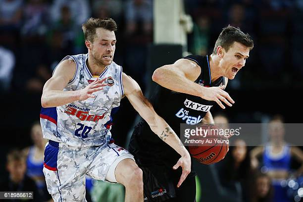 Kirk Penney of New Zealand clashes with Nathan Sobey of Adelaide during the round four NBL match between the New Zealand Breakers and the Adelaide...