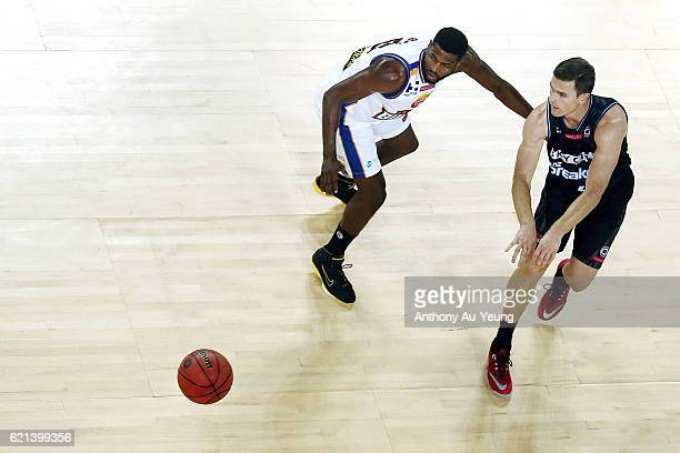 Kirk Penney of New Zealand competes against Jermaine Beal of Brisbane during the round five NBL match between the New Zealand Breakers and the...