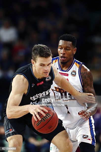 Kirk Penney of New Zealand competes against Torrey Craig of Brisbane during the round five NBL match between the New Zealand Breakers and the...